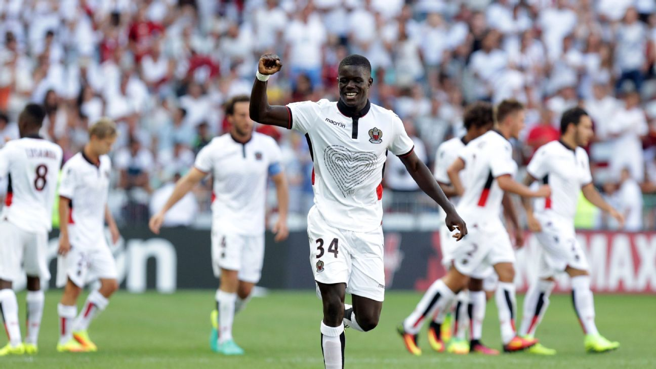 Nice's French defender Malang Sarr celebrates with teammates after scoring a goal during the French L1 football match between Nice and Rennes on August 14, 2016, at the Allianz Riviera stadium in Nice, southeastern France.