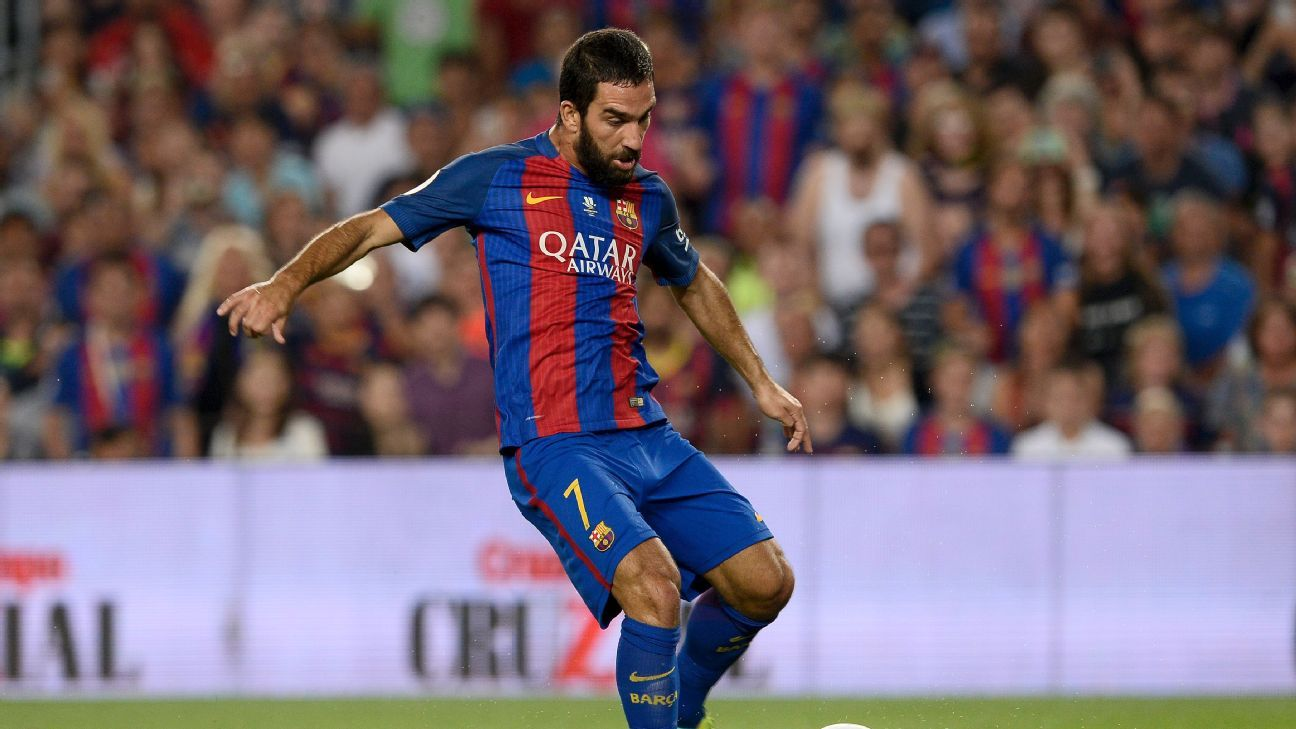 Arda Turan celebrates after scoring one of his two goals in the Spanish Super Cup.