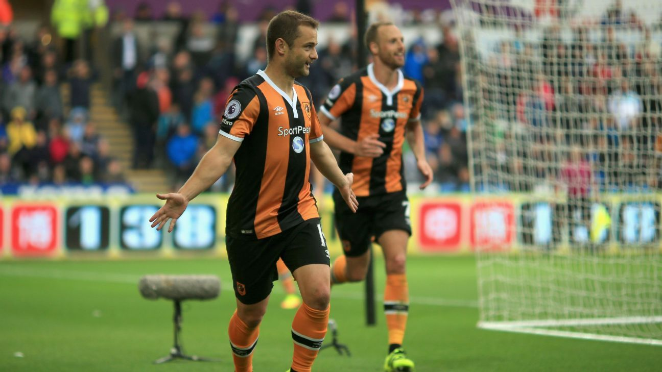 Hull celebrate after Shaun Maloney opens the scoring at Swansea.