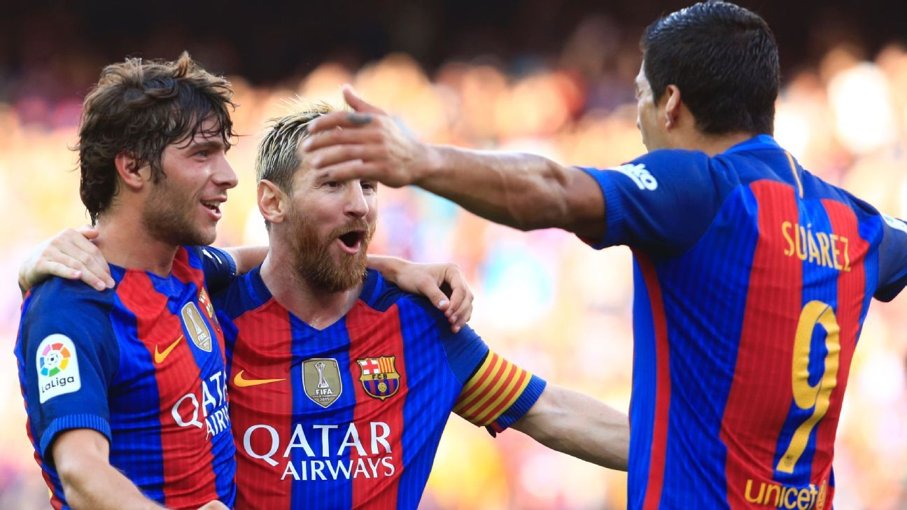 Lionel Messi celebrates with Sergi Roberto (left) and Luis Suarez.
