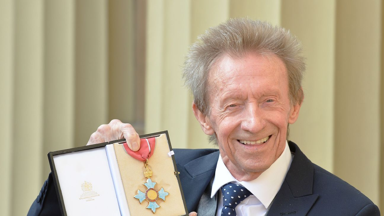 LONDON, UNITED KINGDOM - MARCH 11: Former Scotland and Manchester United footballer Denis Law poses with his  Commander of the Order of the British Empire (CBE) medal that was presented to him by the Duke of Cambridge.