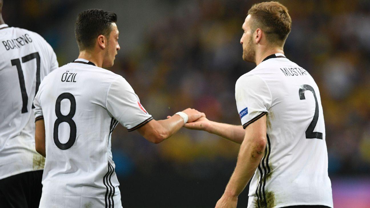 Shkodran Mustafi and Mesut Ozil