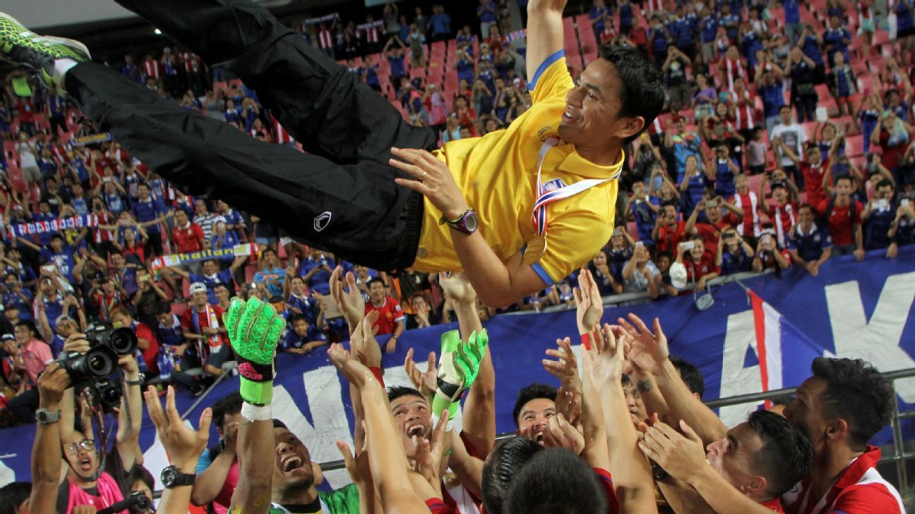 Thailand coach Kiatisuk Senamuang thrown into the air by his players after winning 2016 Kings Cup