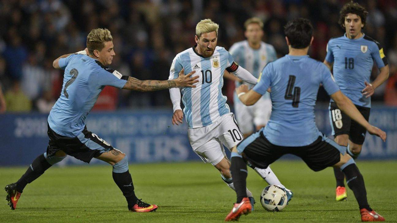 Argentina's Lionel Messi vies for the ball with Uruguay's Jose Maria Gimenez.