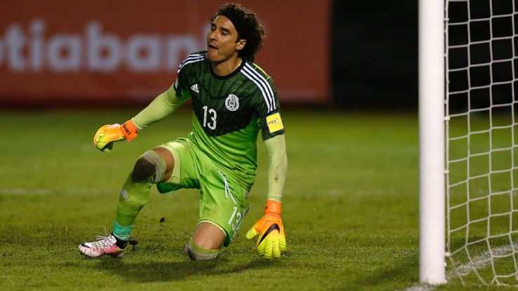 Mexico goalkeeper Guillermo Ochoa reacts after El Salvador scored a penalty against him.