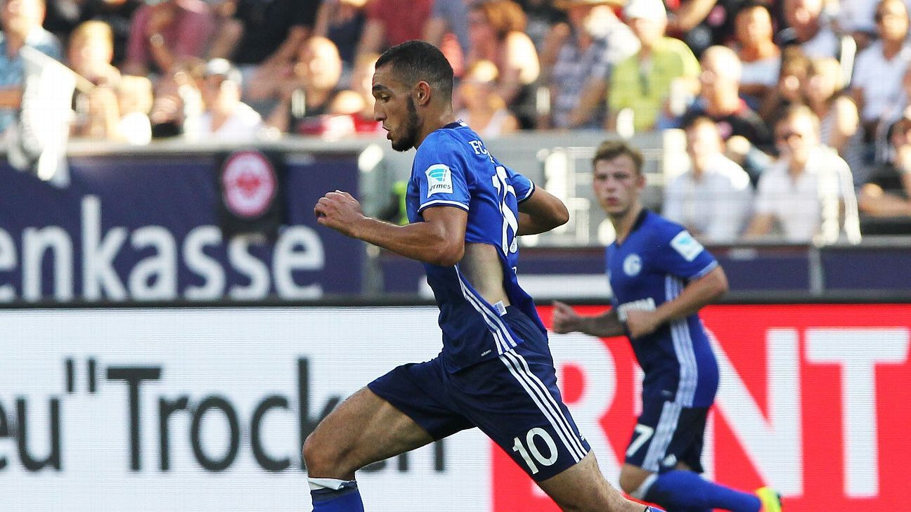Schalke's Algerian midfielder Nabil Bentaleb plays the ball during the German first division Bundesliga football match of Eintracht Frankfurt vs FC Schalke 04 in Frankfurt am Main, western Germany, on August 27, 2016.
