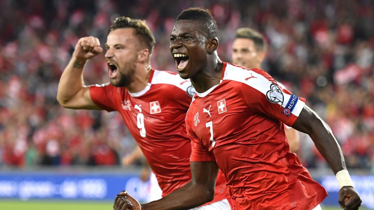 Breel Embolo, right, celebrates after scoring the opener for Switzerland.