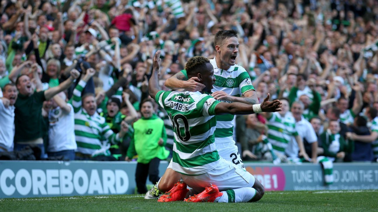 Moussa Dembele celebrates after scoring.