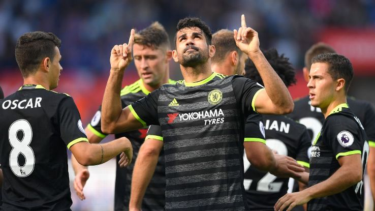Diego Costa celebrates with his Chelsea teammates after opening the scoring at Swansea.