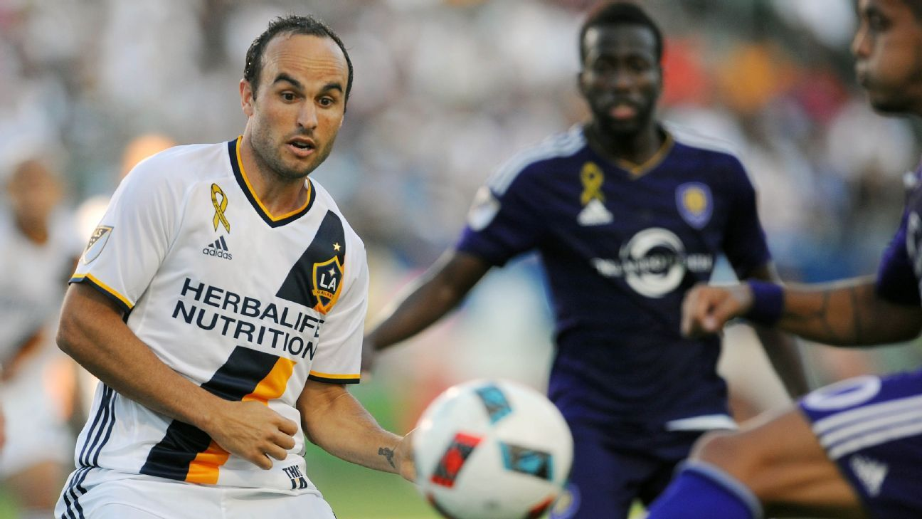 Landon Donovan vies for the ball in his return to play for the LA Galaxy in Major League Soccer.