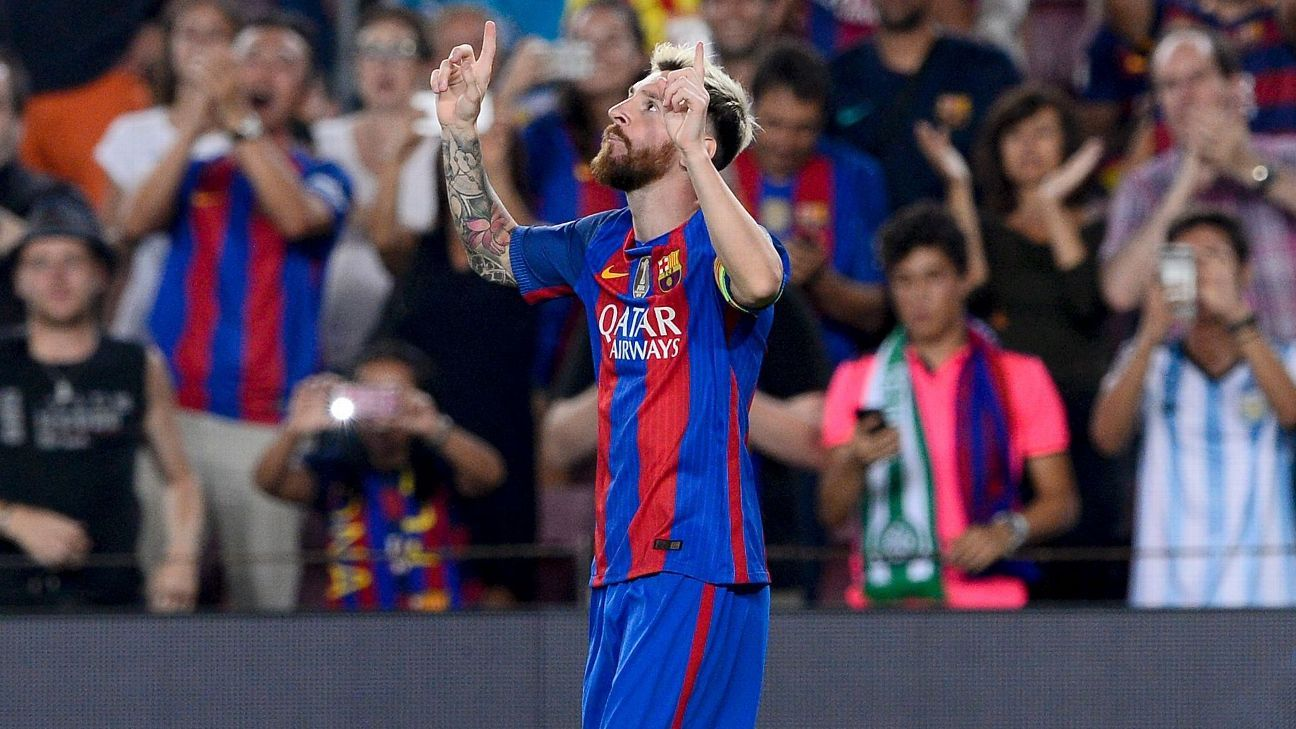 Lionel Messi celebrates scoring a goal in a Champions League thrashing of Celtic.