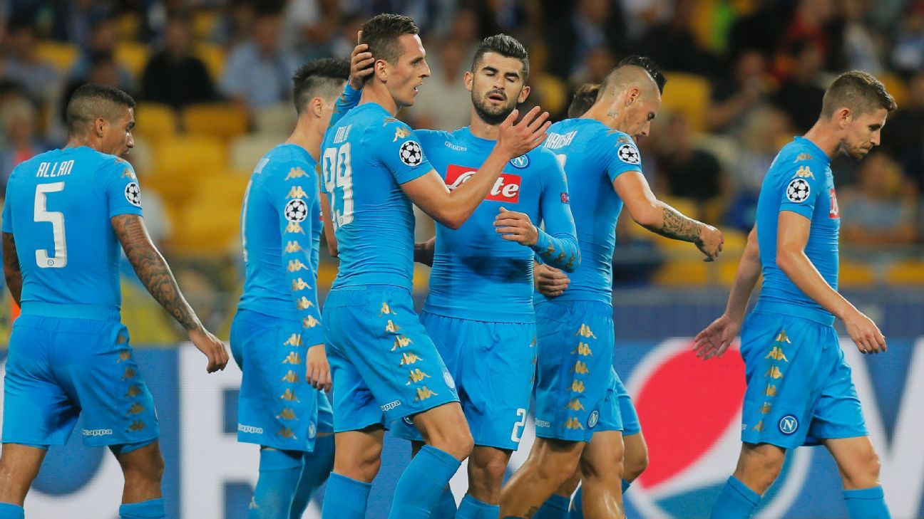 Arkadiusz Milik is congratulated by his Napoli teammates.