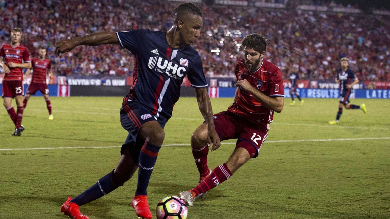 Juan Agudelo works to get around FC Dallas midfielder Ryan Hollingshead at Toyota Stadium during New England's 4-2 loss.