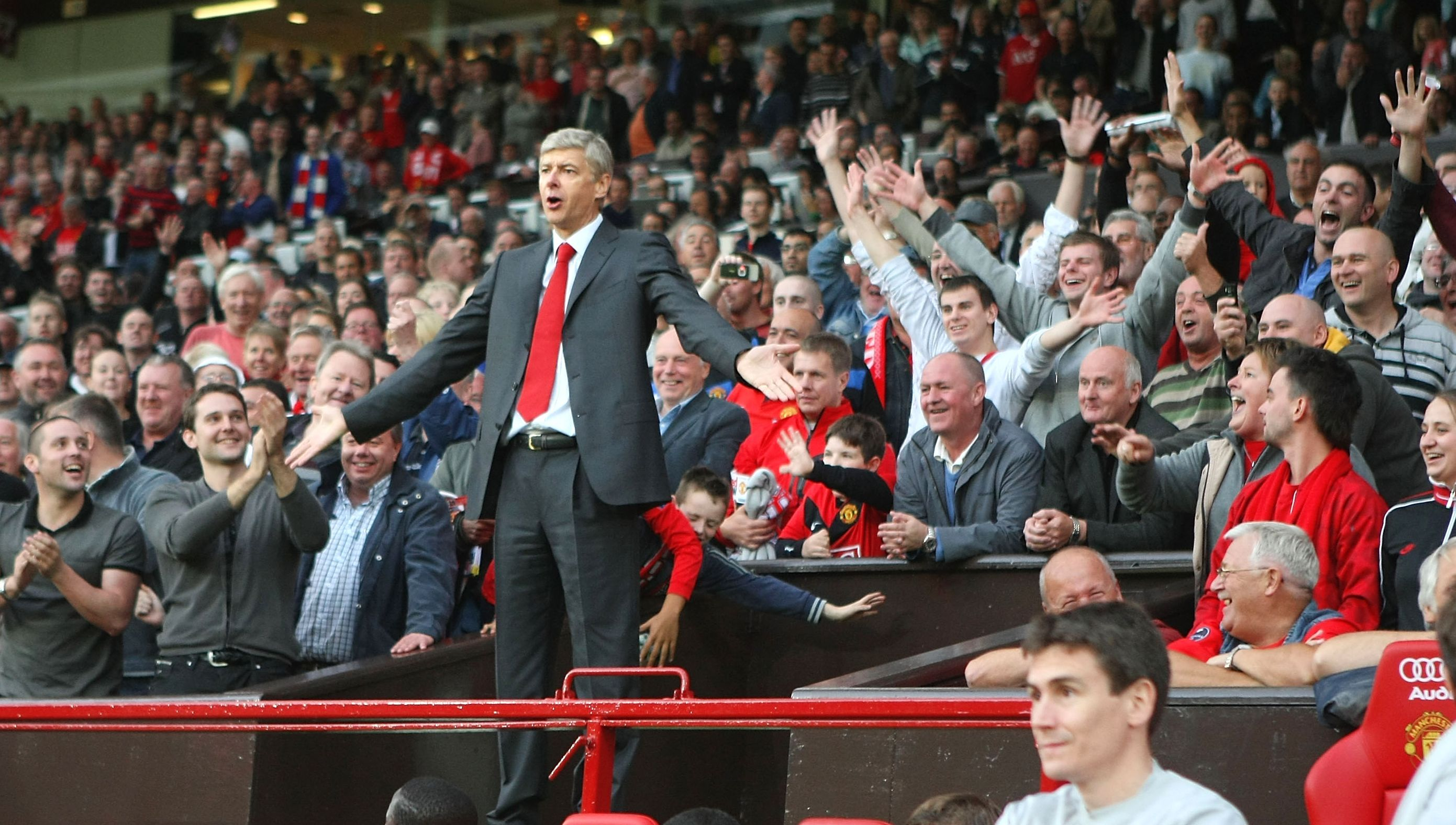 Arsene Wenger was sent to the Old Trafford stands in a 2-1 loss to Manchester United after kicking a water bottle following a disallowed goal.