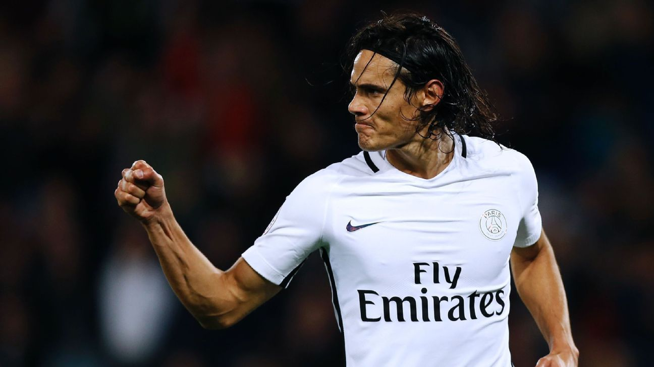 Edinson Cavani celebrates after scoring one of his four goals against Caen.