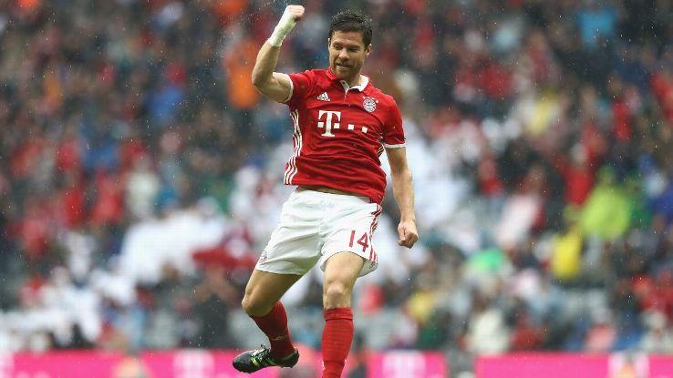 Xabi Alonso celebrates giving Bayern Munich the lead.