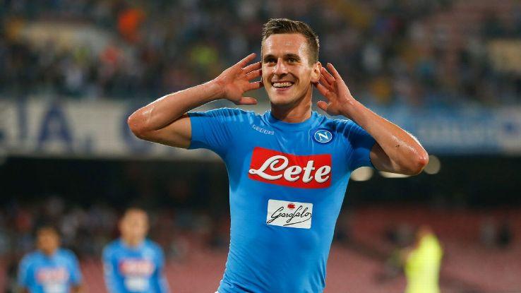 Arkadiusz Milik scored twice to help Napoli win and go top of Serie A.