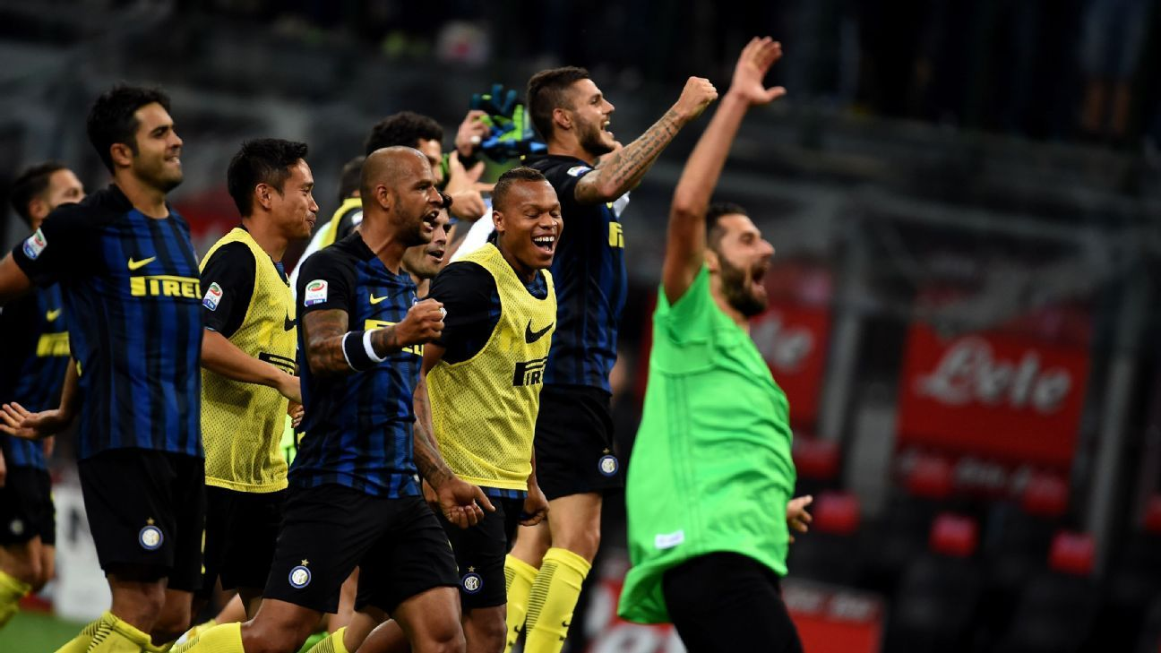 Inter Milan celebrate their stunning defeat of Juventus on Sunday.
