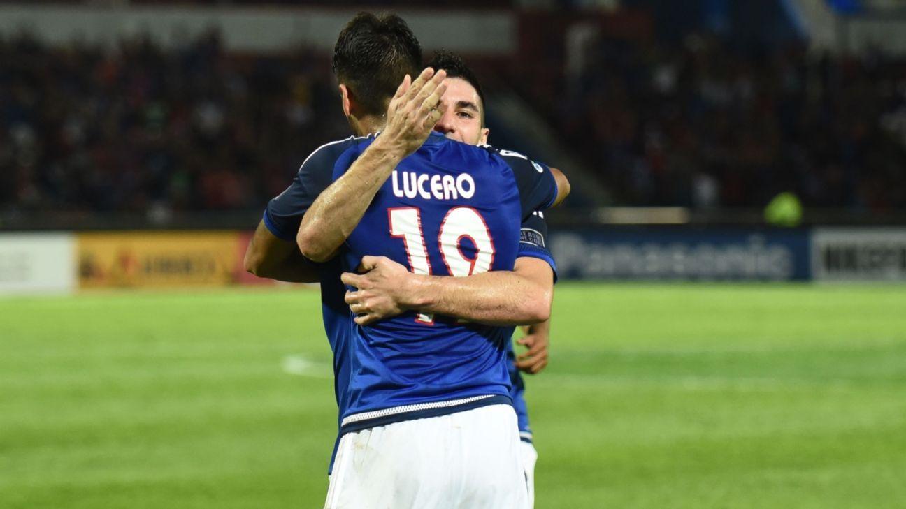 JDT's Diaz and Lucero hug