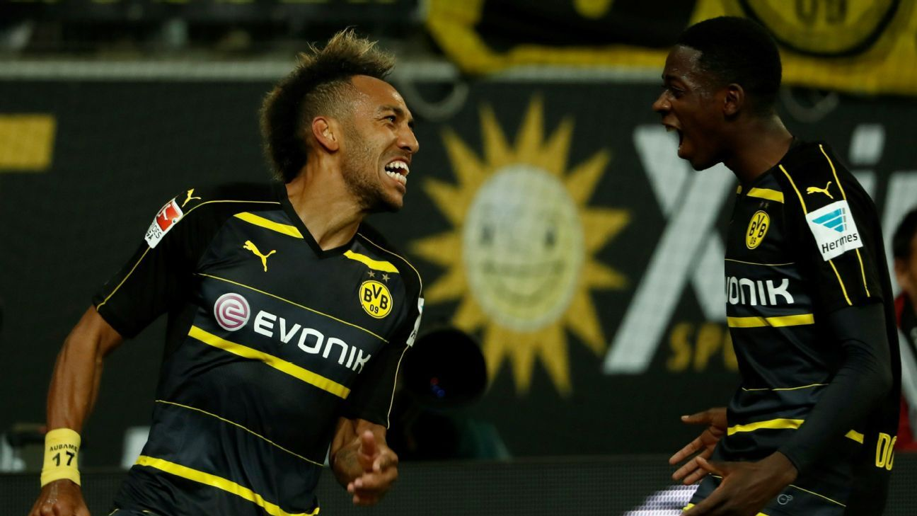 Pierre-Emerick Aubameyang and Ousmane Dembele celebrate after scoring a goal in a win against Wolfsburg.