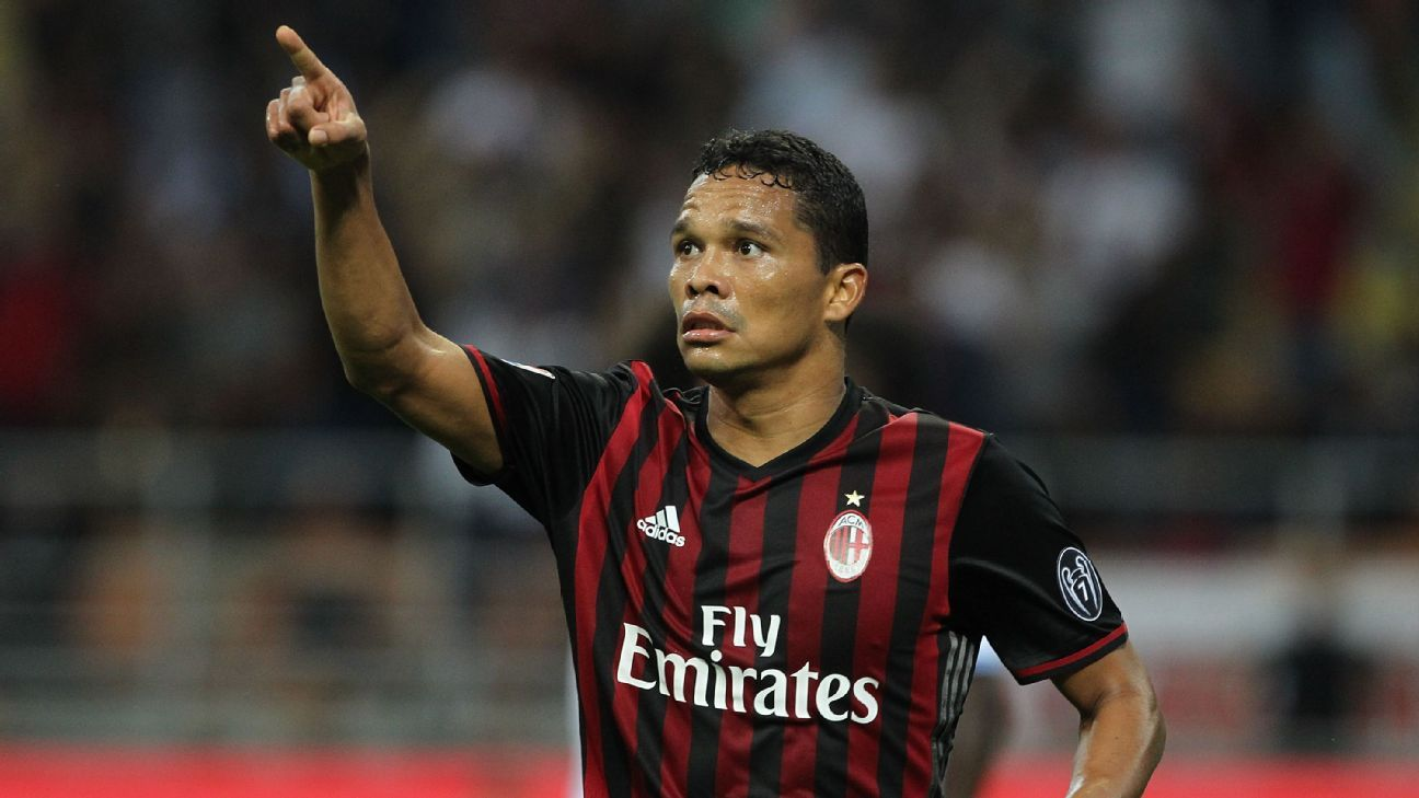 Carlos Bacca celebrates after opening the scoring for AC Milan against Lazio.