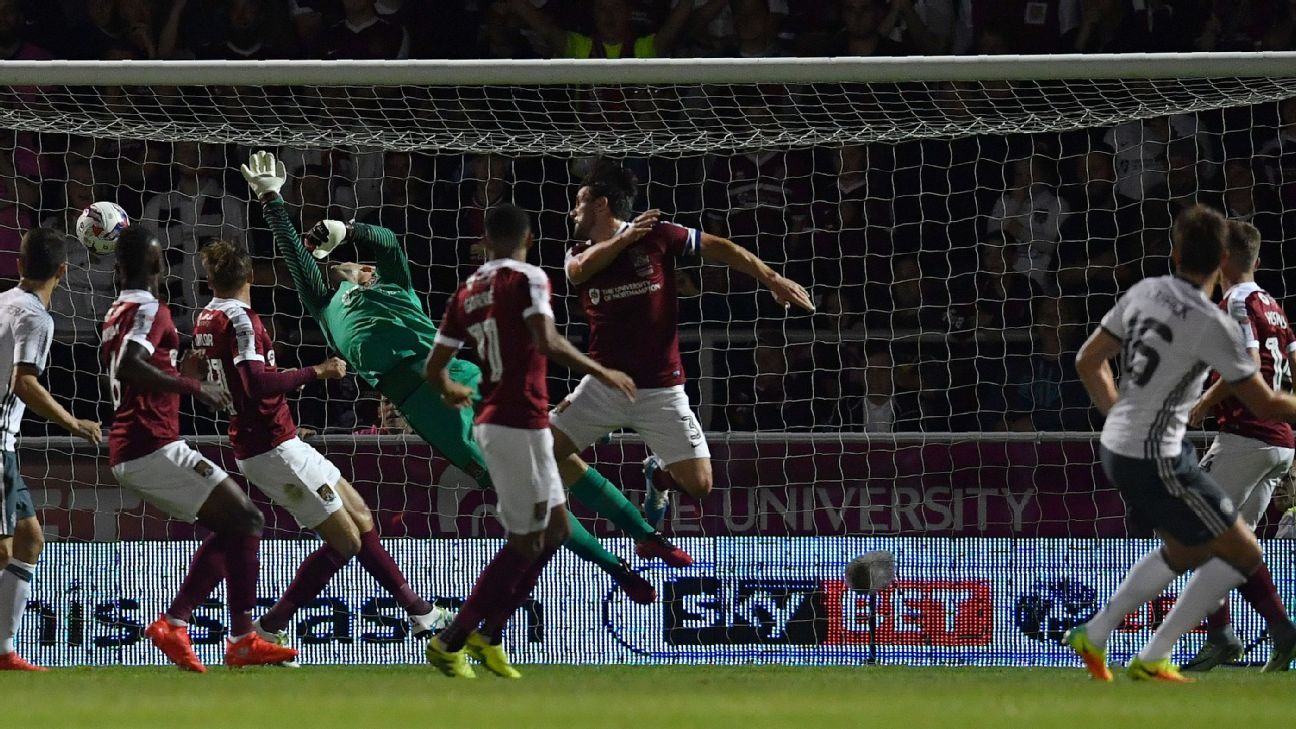 Manchester United scored twice after Michael Carrick's opener to see off Northampton.