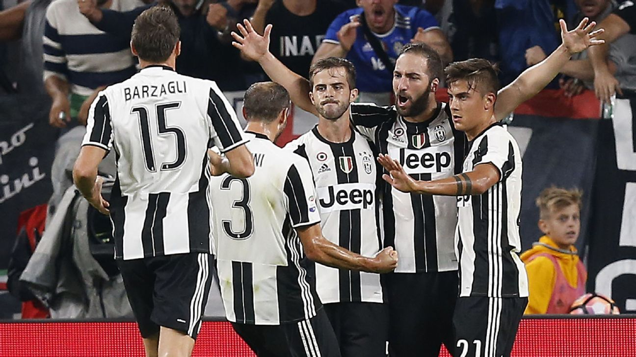 Gonzalo Higuain is mobbed after scoring for Juventus.