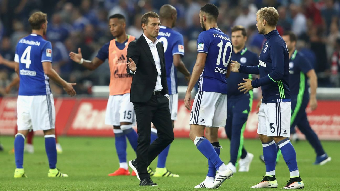 Markus Weinzierl, Manager of of Schalke reacts with Nabil Bentaleb of Schalke following defeat in the Bundesliga match between FC Schalke 04 and Bayern Muenchen at Veltins-Arena on September 9, 2016 in Gelsenkirchen, Germany.