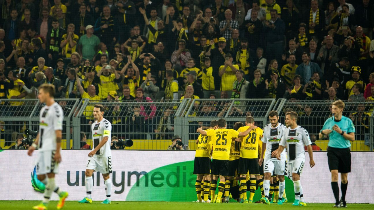 Dortmund players celebrate a first-half goal by Pierre-Emerick Aubameyang in a win against Freiburg.