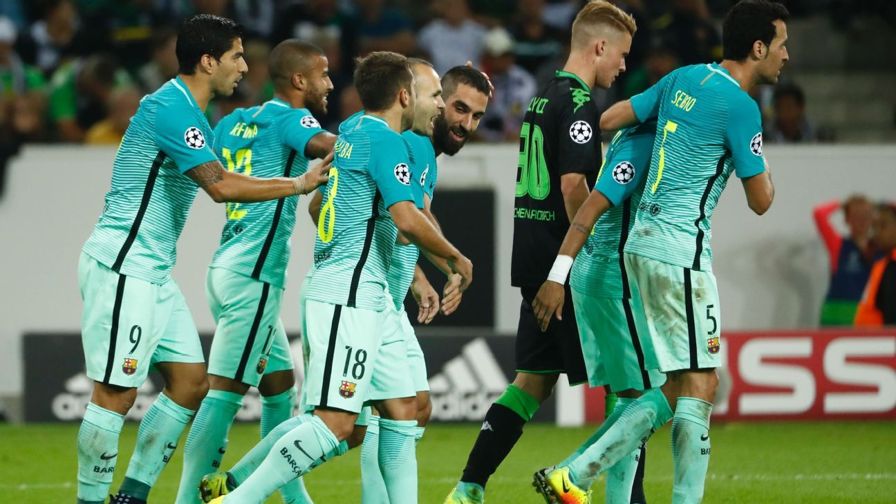 Barcelona players celebrate after Arda Turan scored to draw them level with Gladbach.