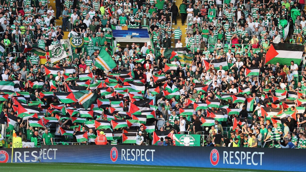 Palestinian flags are waved by fans during the UEFA Champions League Play-off First leg match between Celtic and Hapoel Beer-Sheva at Celtic Park on August 17, 2016 in Glasgow, Scotland.