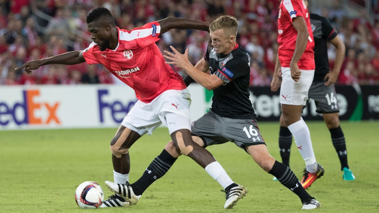Hapoel Be'er Sheva's John Ogu holds off Southampton's James Ward-Prowse.