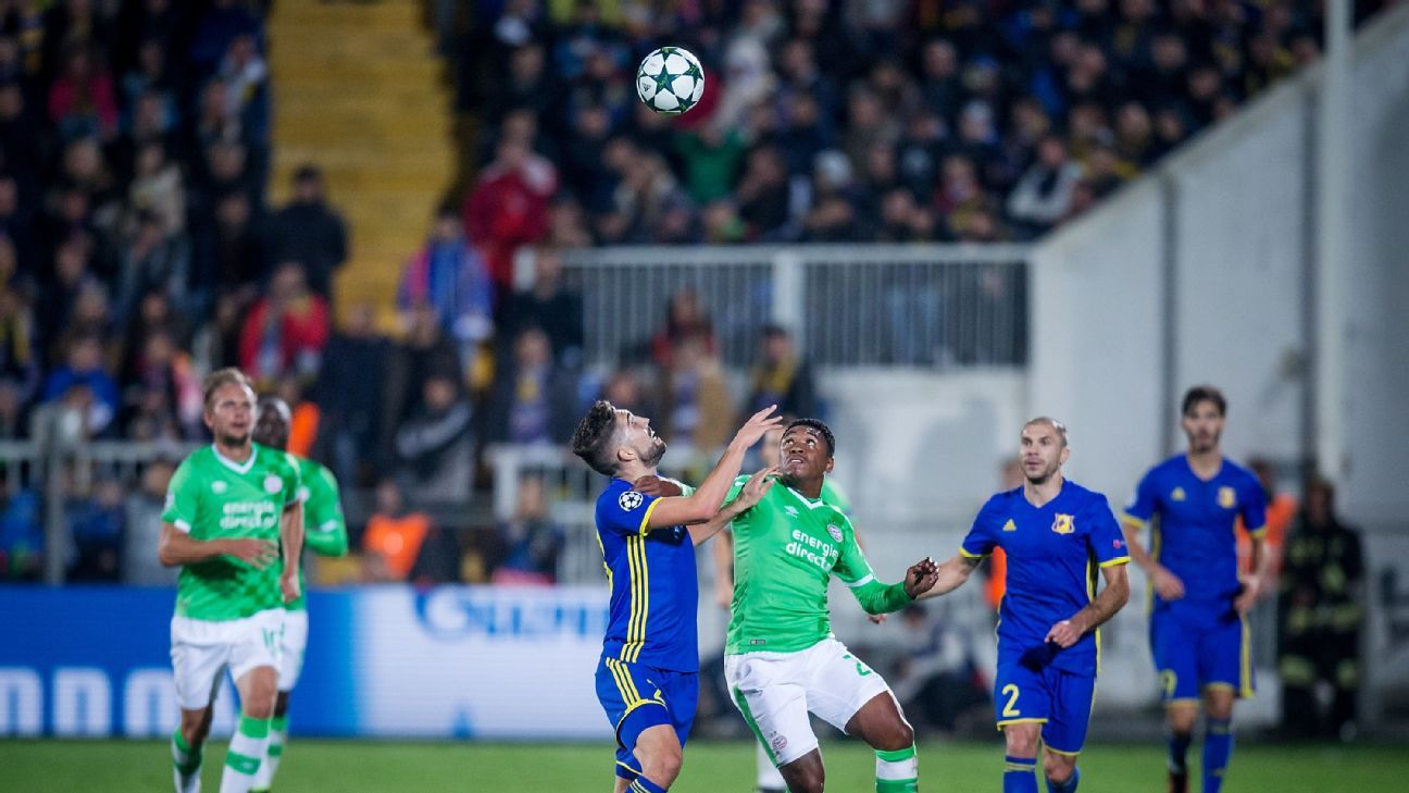 Miha Mevlja of FC Rostov competes with Steven Bergwijn of PSV Eindhoven during the UEFA Champions League match between FC Rostov and PSV Eindhoven at Olimp-2 on September 28, 2016 in Rostov-on-Don.