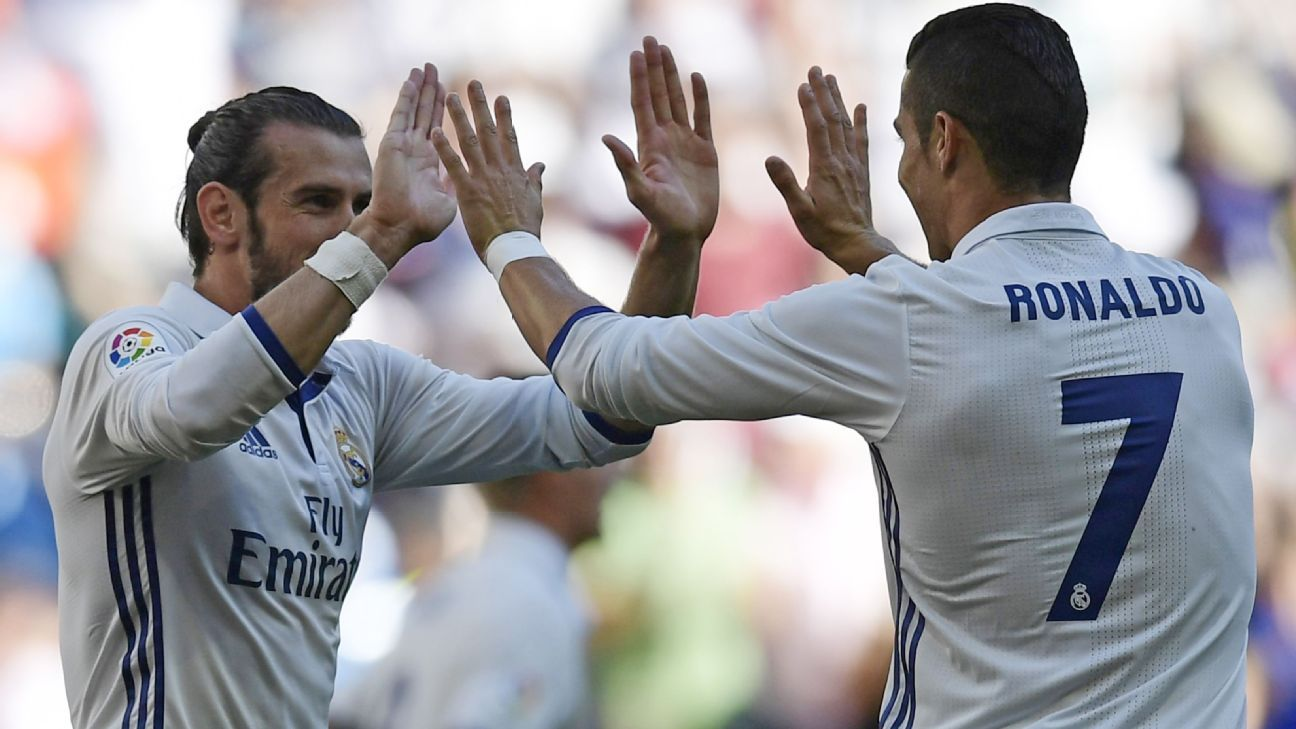 Gareth Bale and Cristiano Ronaldo celebrate Real Madrid's equaliser.