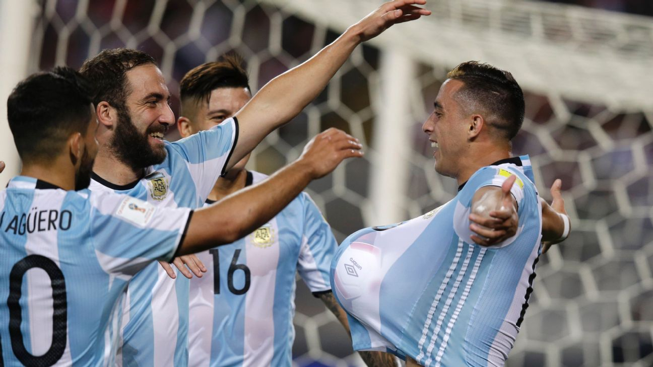 Argentina's Ramiro Funes Mori, right, celebrates with his teammates after scoring against Peru.