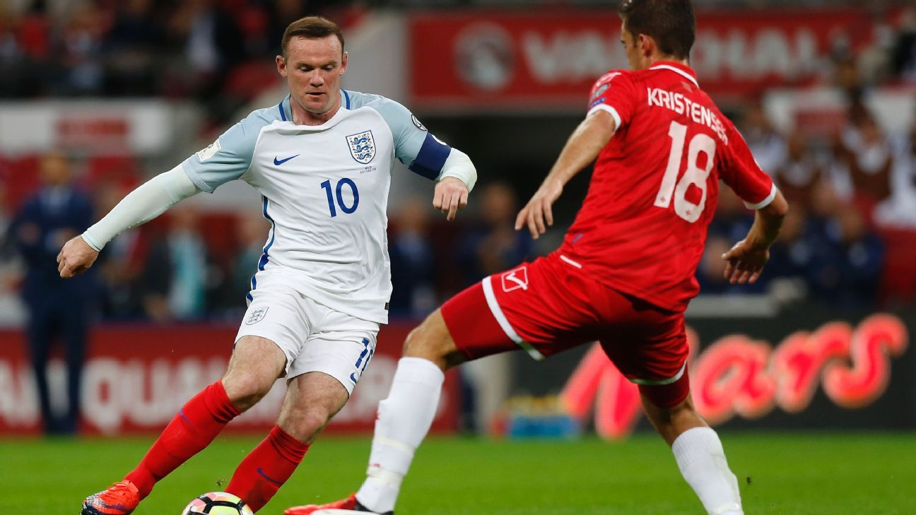 England's captain Wayne Rooney (L) vies with Malta's midfielder Bjorn Kristensen during the World Cup 2018 football qualification match between England and Malta at Wembley Stadium in London on October 8, 2016.