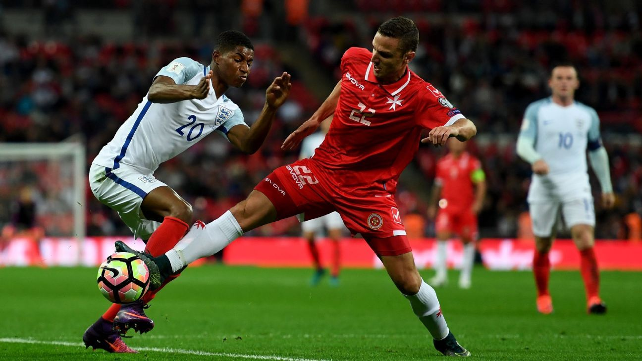 Marcus Rashford of England holds off pressure from Alex Muscat of Malta during the FIFA 2018 World Cup Qualifier Group F match between England and Malta at Wembley Stadium on October 8, 2016 in London, England.