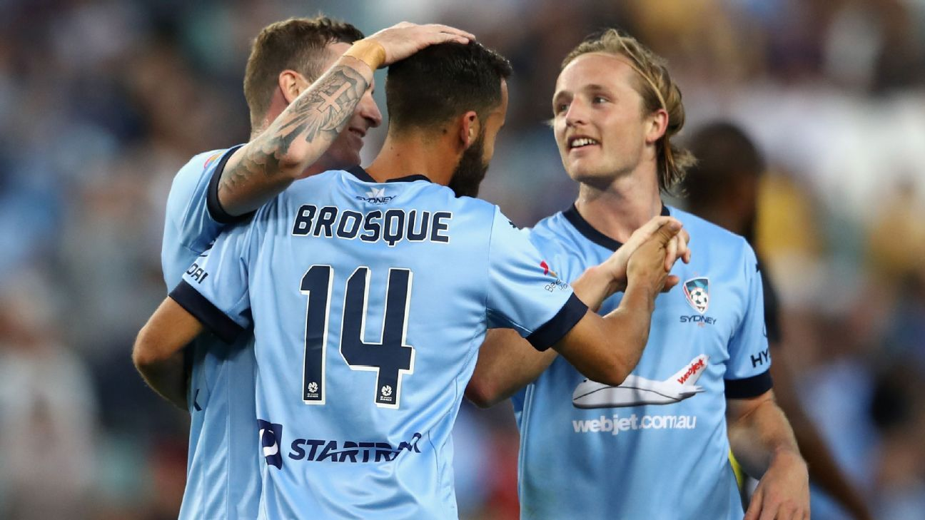 Alex Brosque celebrates with his Sydney FC teammates after scoring against the Mariners.