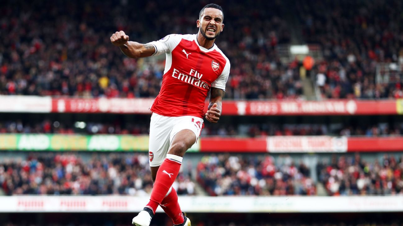 Theo Walcott celebrates after scoring against Swansea.