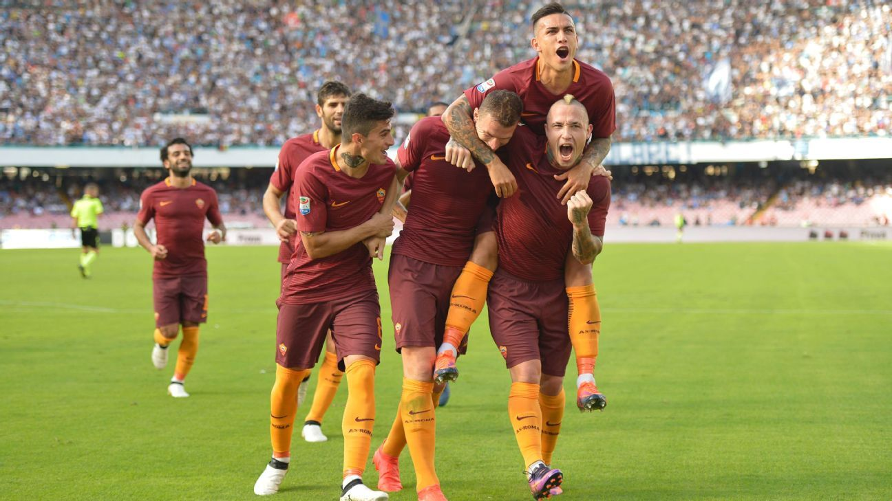 Edin Dzeko scored twice as Roma secured victory at Napoli.