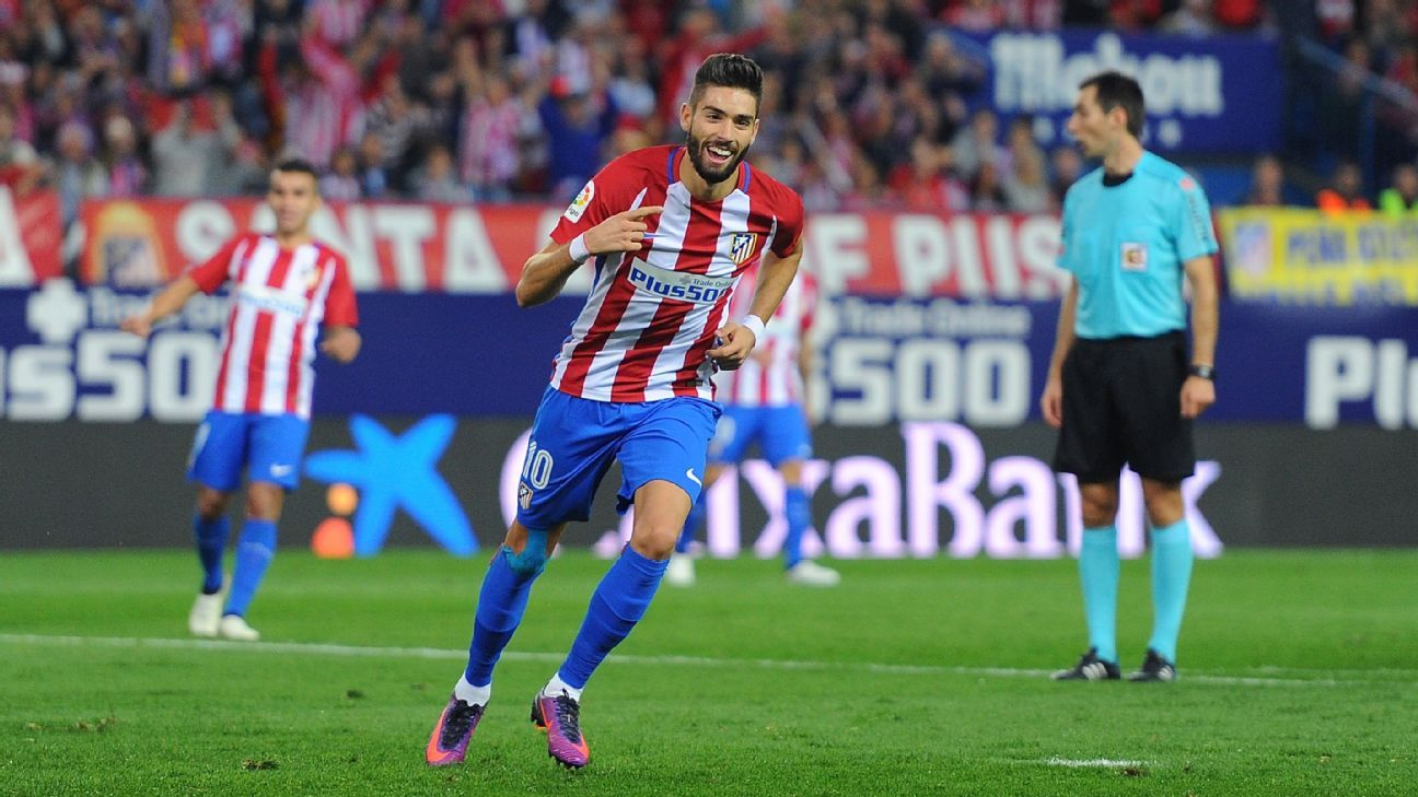 Yannick Carrasco celebrates his hat-trick goal against Granada.