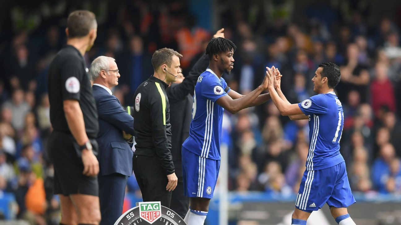 Nathaniel Chalobah of Chelsea (L) is subbed on for Pedro of Chelsea (R)  during the Premier League match between Chelsea and Leicester City at Stamford Bridge on October 15, 2016 in London, England.