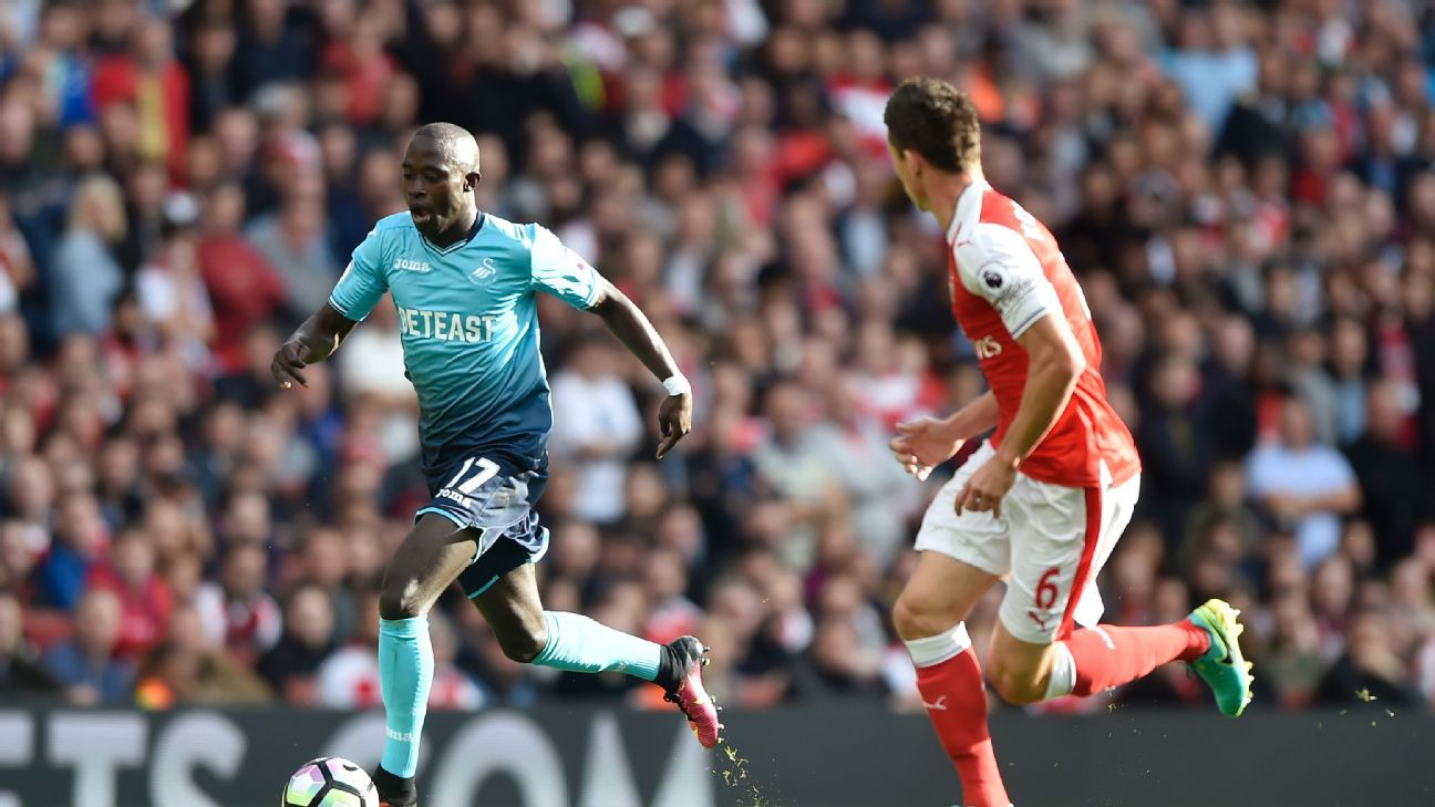 Britain Football Soccer - Arsenal v Swansea City - Premier League - Emirates Stadium - 15/10/16  Swansea City's Modou Barrow in action with Arsenal's Laurent Koscielny