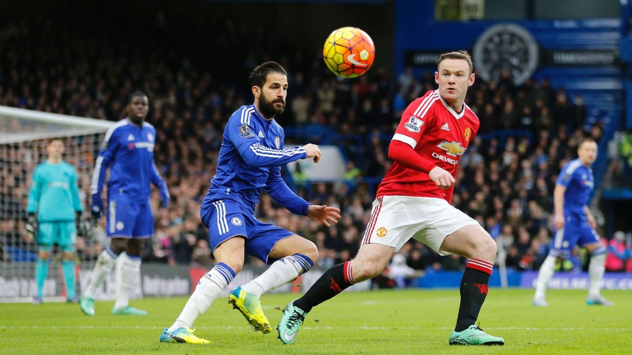 Manchester United's captain Wayne Rooney, right, eyes the ball as Chelsea's Cesc Fabregas watches during the English Premier League soccer match between Chelsea and Manchester United at Stamford Bridge stadium in London, Sunday, Feb. 7, 2016.