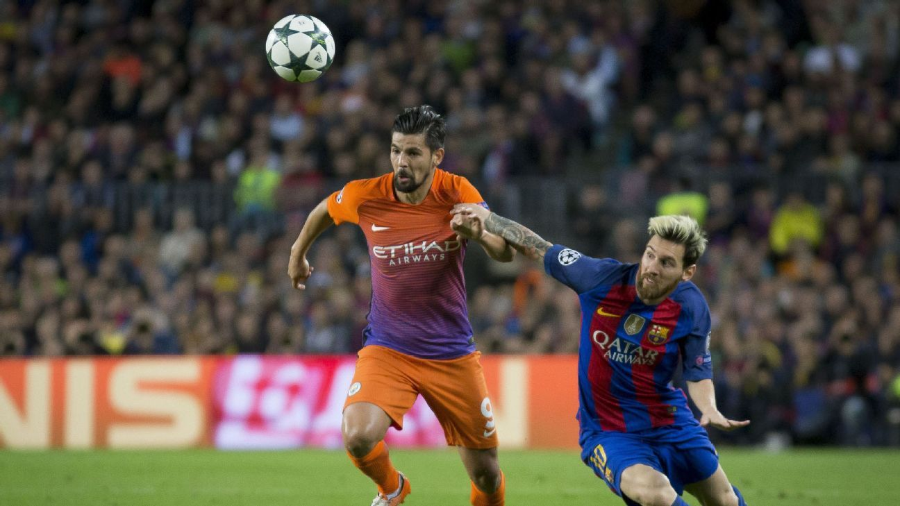 Barcelona's Leo Messi vies with Mancheser's Nolito during the UEFA Champions League match between FC Barcelona and Manchester City at Camp Nou Stadium in Barcelona, Spain on October 19, 2016.