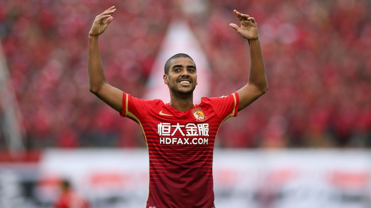 GUANGZHOU, CHINA - MAY 14:  (CHINA OUT) Alan Carvalho #7 of Guangzhou Evergrande celebrates after scoring his team's second goal during the Chinese Football Association Super League match between Guangzhou Evergrande and Hebei China Fortune at Tianhe Stad