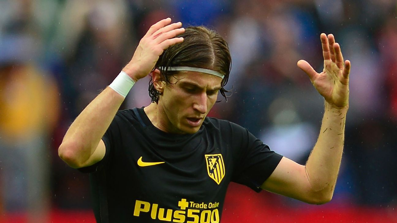 Atletico Madrid's Brazilian defender Filipe Luis gestures during the Spanish league football match between Sevilla FC and Club Atletico de Madrid at the Ramon Sanchez Pizjuan stadium in Sevilla on October 23, 2016.