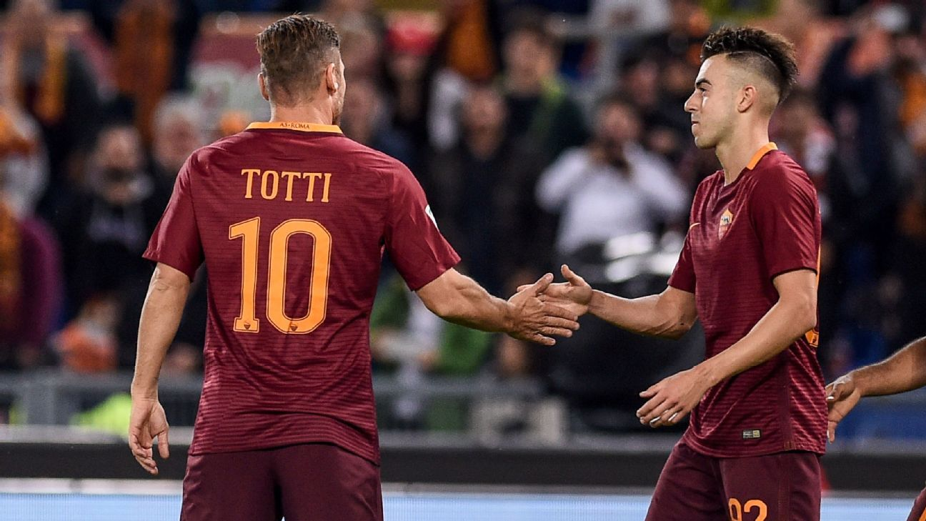 Stephan El Shaarawy celebrates with teammate Francesco Totti after scoring a goal against Palermo.