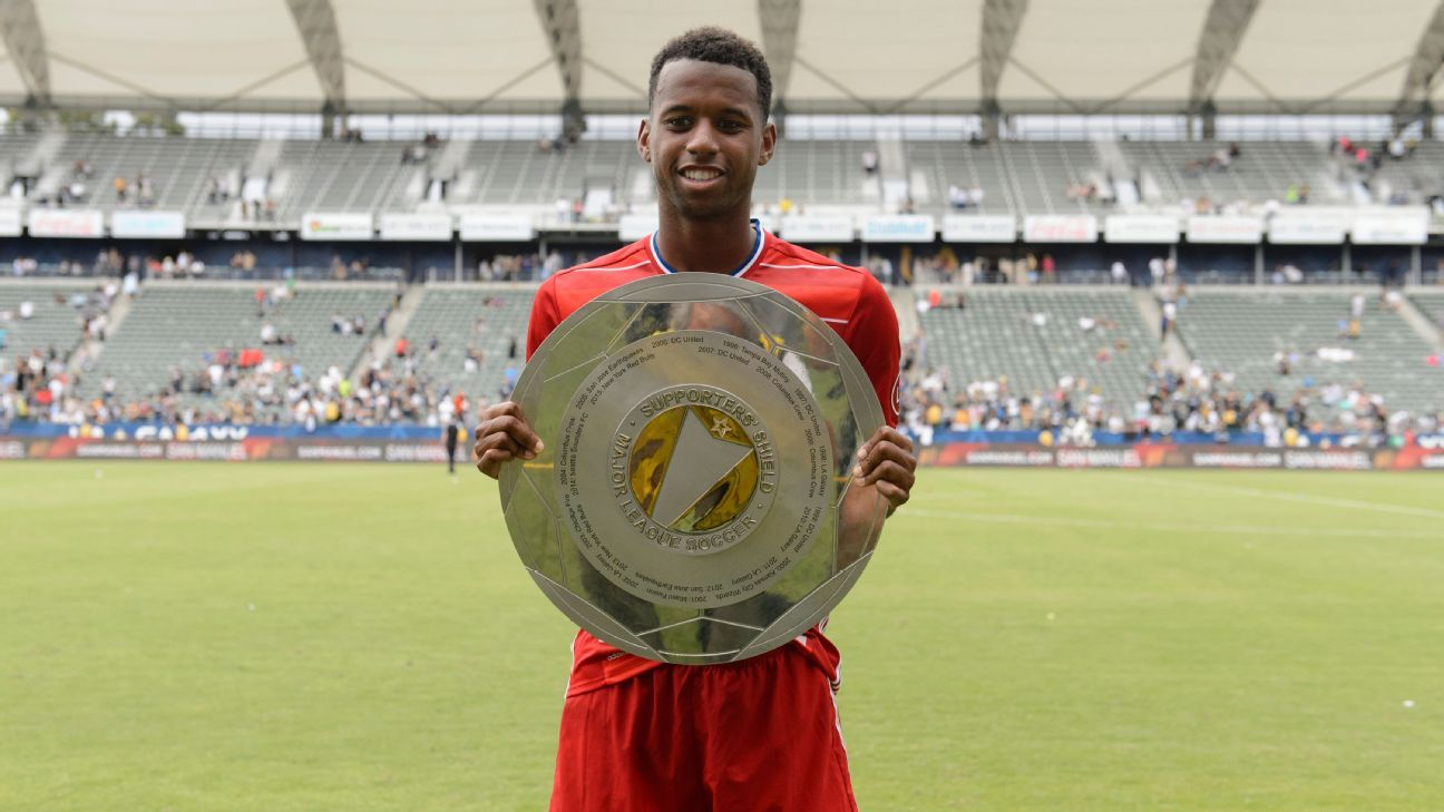 Kellyn Acosta lifts the Supporters' Shield