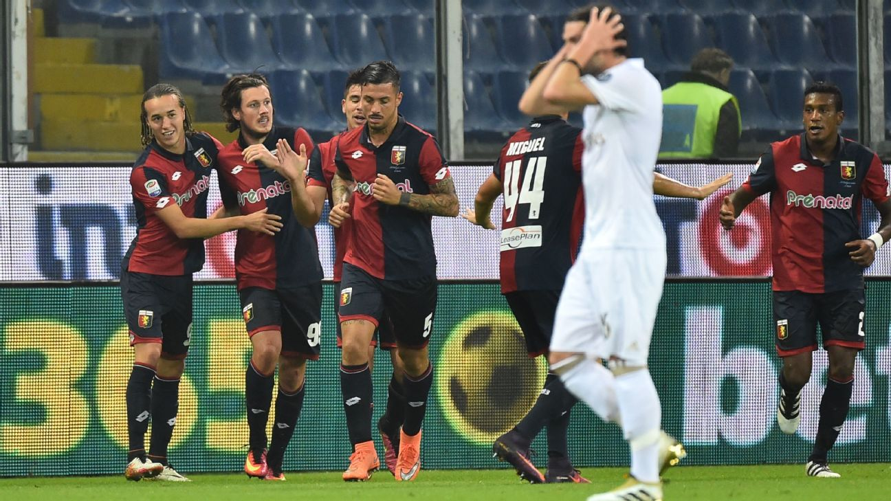 Nicola Ninkovic and Genoa ran out to a 3-0 victory over 10-man Milan.